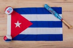 Baseball and baseball bats on a flag of Cuba