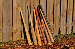 Baseball Bats Leaning on a Fence Royalty Free Stock Images
