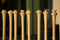 Baseball Bats in Window of Wood Shop. Baseball bats in various stages of being built on display in the window of a wood shop Royalty Free Stock Photos