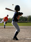 Baseball batter and pitcher. Young boy waiting for pitch delivery from pitcher in baseball game Stock Image