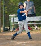 Baseball Batter Swinging. Baseball batter swining bat during game Royalty Free Stock Photo