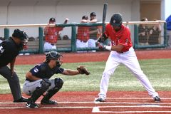 Baseball batter watches breaking ball Stock Photos