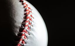 Baseball on a black background in a macro, free space Royalty Free Stock Image
