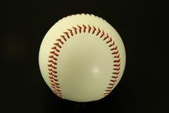 Baseball on Black, Horizontal. White Baseball on Black, Horizontal Alignment royalty free stock images