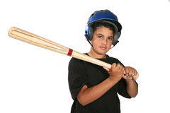 Baseball Boy. A young boy swinging the bat in a game of baseball Royalty Free Stock Images