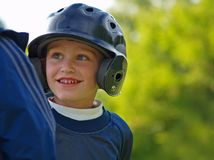Baseball boy. Boy interacting with his base coach during a baseball game Royalty Free Stock Image