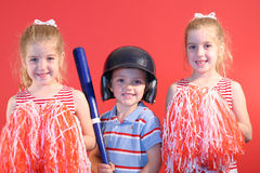 Baseball boy & cheerleaders. Shot of a baseball boy & cheerleaders Royalty Free Stock Photography