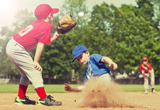 Baseball. Boy sliding into base during a baseball game with Instagram style filter Stock Photo