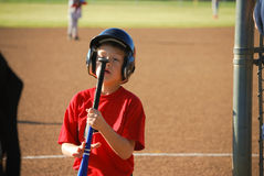 Baseball boy staring at bat Stock Photography