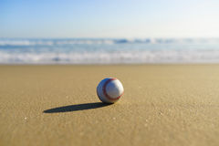 Baseball at a California beach with white wave in Pacific Ocean Stock Photo
