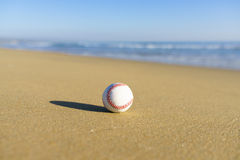 Baseball at a California beach with white wave in Pacific Ocean Stock Photography