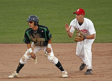 Baseball canada cup baserunner shortstop. Saskatchewan baserunner Nolan Benesh and Ontario shortstop Mitchell Triolo at the 2011 Baseball Canada Cup August 14 Royalty Free Stock Photography