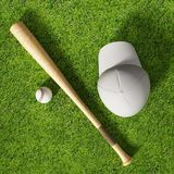 Baseball cap, ball and bat standing on grass field. 3D illustration.  Royalty Free Stock Photo