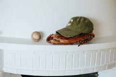 Baseball cap, ball and glove Stock Photo