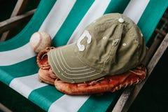 Baseball cap, ball and glove Royalty Free Stock Photos