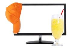 Baseball cap, juice, computer monitor Stock Images