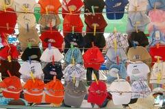 Baseball caps. Different baseball caps hanging on display Stock Photos