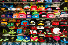 Baseball caps with different brand names. SIDE, TURKEY - JULY 07, 2015: Baseball caps with different brand names. Shop on the waterfront. Anatolian coast - a Stock Images
