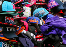 Baseball caps in NY. New York City, USA - May 19, 2014: A variety of baseball caps at a market stall. Most are labeled with 'New York Royalty Free Stock Photography