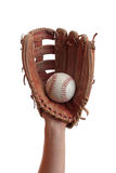 Baseball Catch. A worn baseball glove catches a baseball Royalty Free Stock Photos