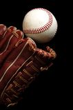 Baseball catch. Close up of a baseball glove attempting to cacth the ball Royalty Free Stock Photos