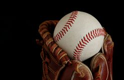 Baseball catch. Close up of a well worn baseball glove catching the ball Stock Photography