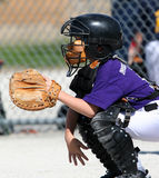 Baseball catcher. Child playing catcher in baseball game Stock Photography