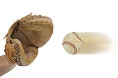 Baseball catcher catching a speeding baseball. A Baseball catcher catching a speeding baseball isolated on a white background Royalty Free Stock Image