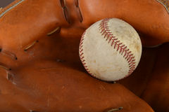 Baseball on Catcher Glove Stock Image