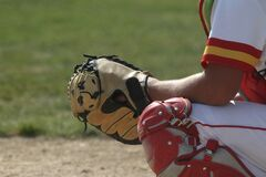 Baseball Catcher Crouches Behind the Plate