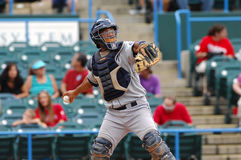Baseball catcher throws to second base. CAMDEN, NJ - AUGUST 15: Bridgeport Bluefish catcher Luis Rodriguez makes a throw to second base in an Atlantic League royalty free stock images