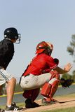 Baseball Catcher And Umpire On Field. Rear view of catcher and umpire on baseball field stock image