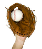 Baseball caught in glove Stock Image