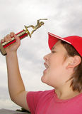 Baseball champ. Boy holds trophy in the air Royalty Free Stock Images