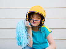Baseball cheerleading pom poms girl happy smiling. With yellow helmet Stock Photos