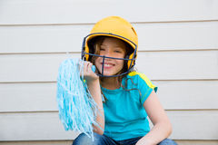 Baseball cheerleading pom poms girl happy smiling Royalty Free Stock Photo