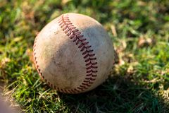 Baseball Close Up on Field. Well Worn Baseball Close Up on Field Royalty Free Stock Photography