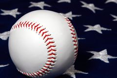 Baseball close-up on flag. Close-up of a new baseball on American flag Royalty Free Stock Images