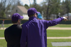 Baseball Coach. Coaches at a high school baseball game on a sunny day in Maine Stock Photography