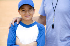 baseball coach with hand on boy's shoulder Stock Image