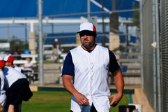 Baseball coach walking across field. Stock Images