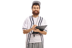 Baseball coach writing in a clipboard Royalty Free Stock Photography