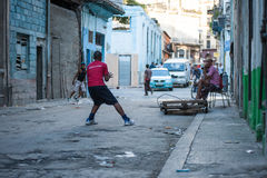 Baseball. A couple of boys play baseball in the streets of Havana, Cuba Stock Photography