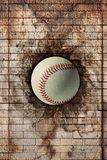 Baseball. 3d rendering of a baseball ball embedded in a stone wall Royalty Free Stock Photography