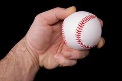 Baseball della holding dell'uomo Fotografie Stock