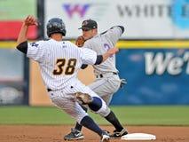 Baseball della Lega Minore - girare due Fotografie Stock Libere da Diritti
