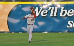 Baseball della Lega Minore - sistemare una sfera di mosca Fotografia Stock Libera da Diritti