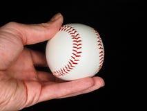 Baseball in der Hand lizenzfreies stockbild