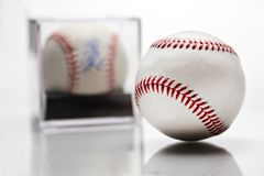 Baseball With Display Case Autographed Memorabilia Blurred In Background Isolated On White stock images