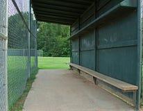 Baseball dugout. Empty green baseball dugout and bench Royalty Free Stock Photos